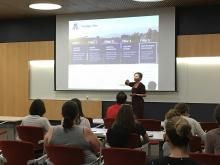 Darcy Van Patten presenting before the audience at a Trellis Open Forum